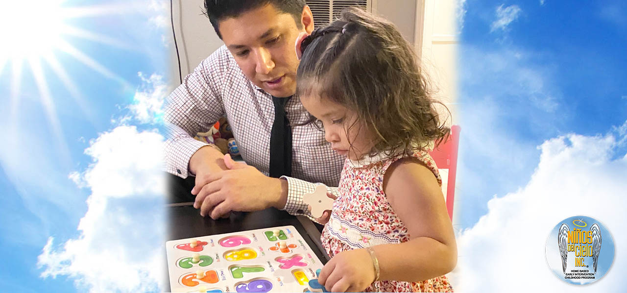 Female toddler learning alphabet with teacher
