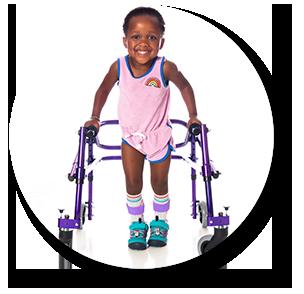 female toddler using walker