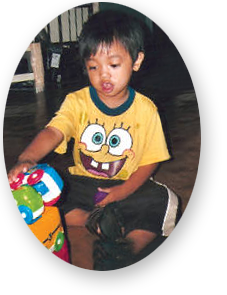 male toddler playing with toys